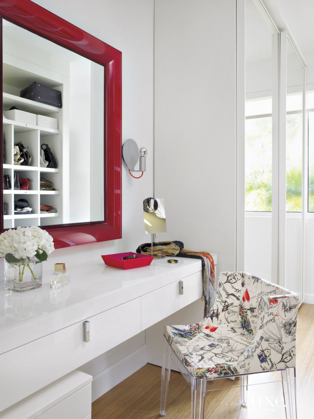 Modern White Closet with Lucite Chair