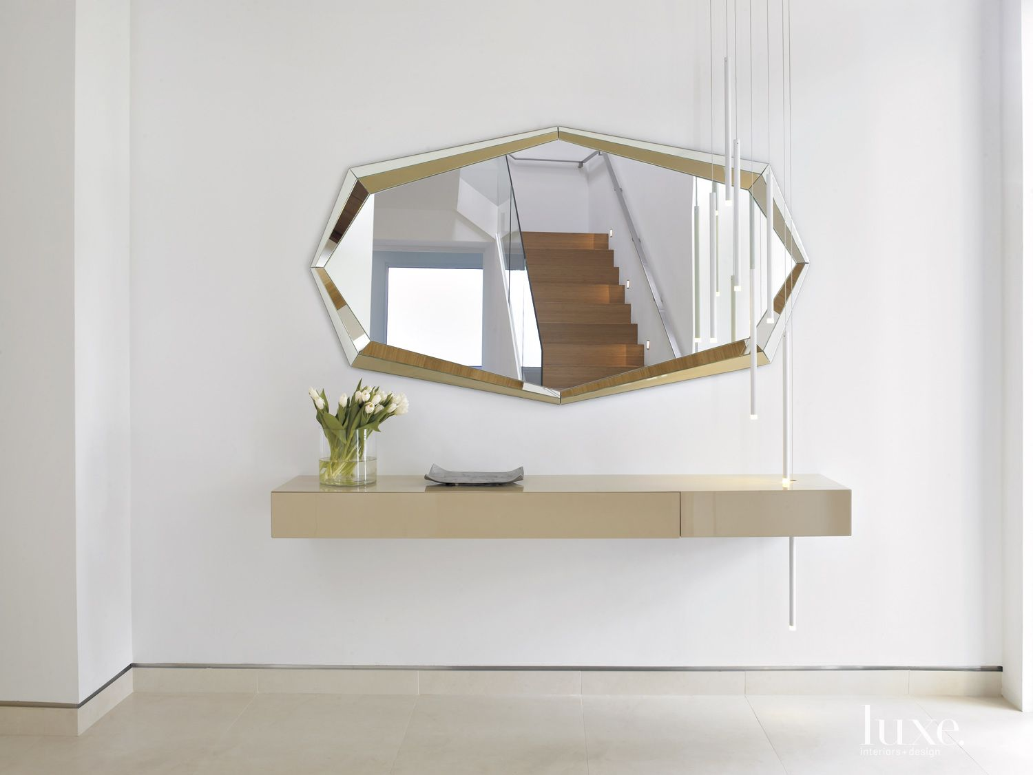 Modern White Hall Detail with Sculptural Mirror