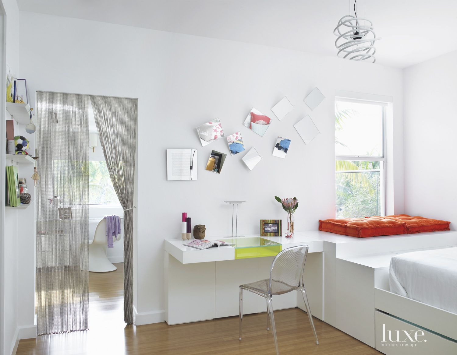 Modern White Bedroom with Orange Accent