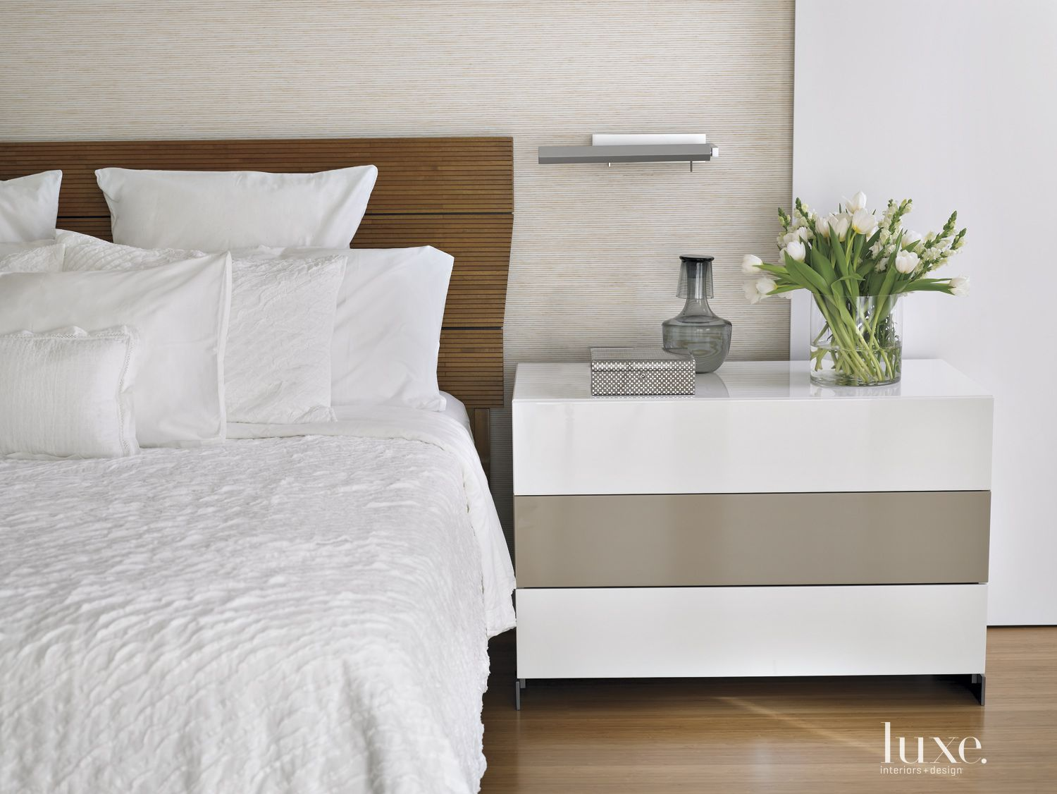 Modern White Bedroom Detail with Lacquered Side Table