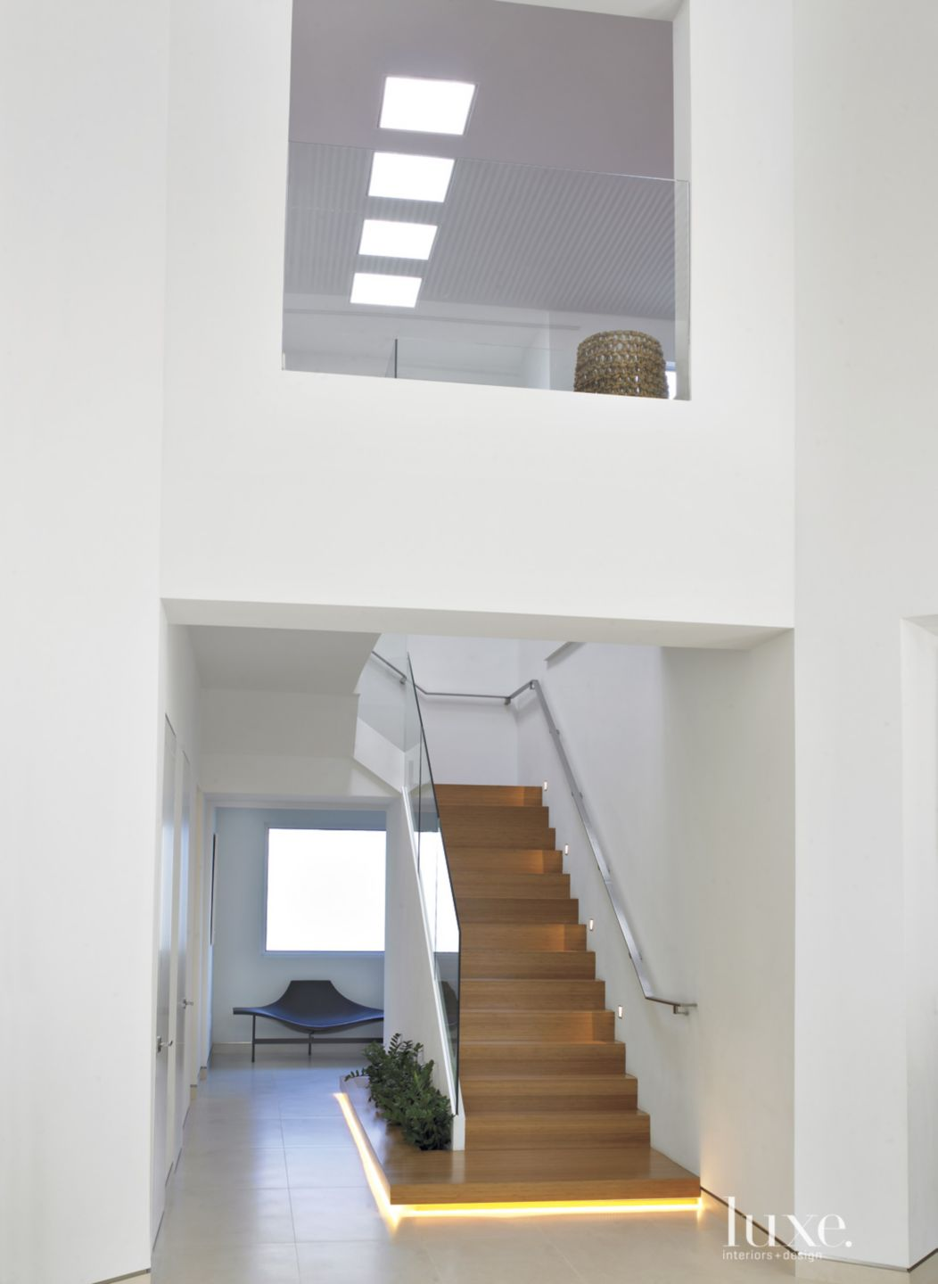 Modern White Staircase with Base Lighting