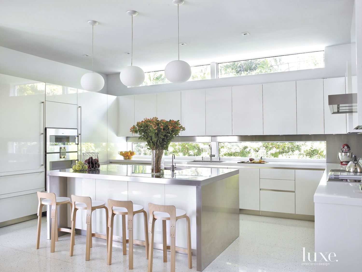 Modern White Kitchen with Globe Pendants