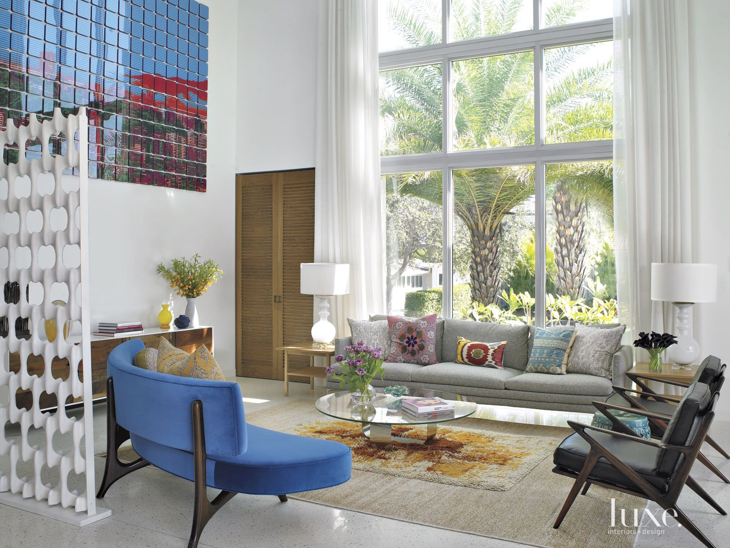 Eclectic White Living Room with Blue Curved Sofa