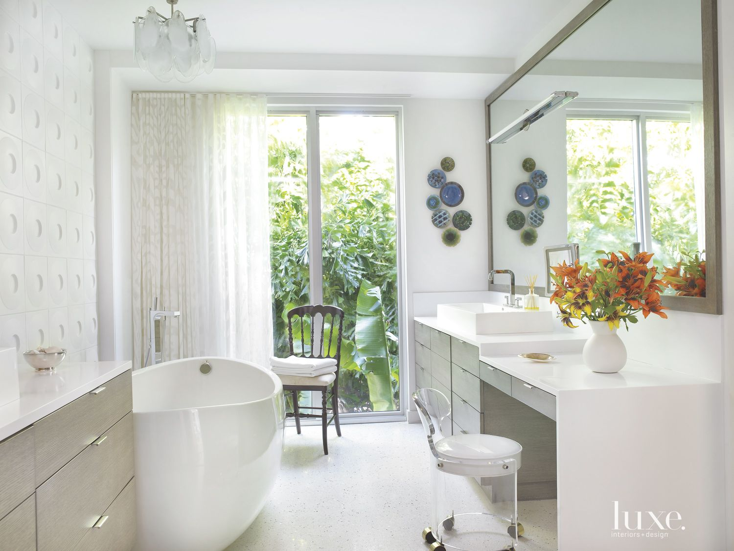 Modern White Bathroom with Lucite Chair