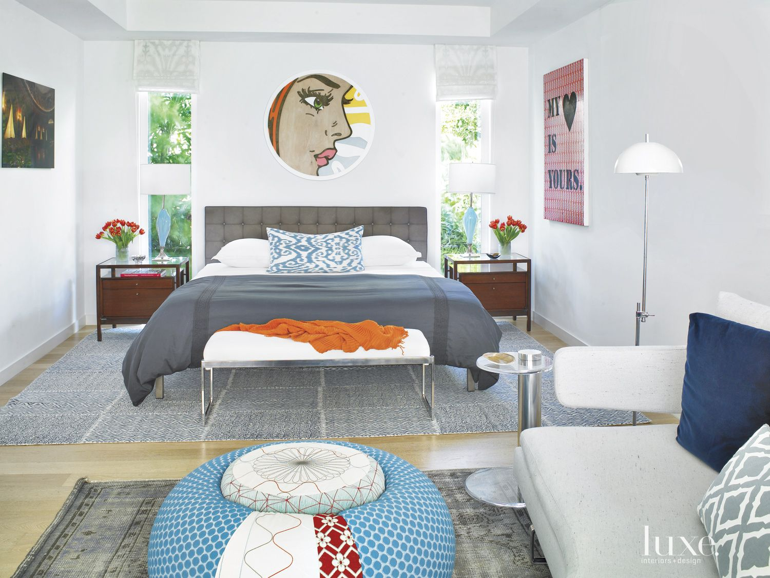 Eclectic White Bedroom with Narrow Windows
