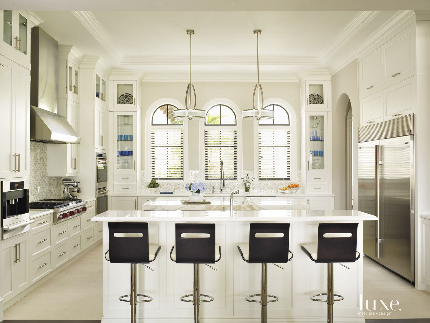 Contemporary White Kitchen with Arched French Windows