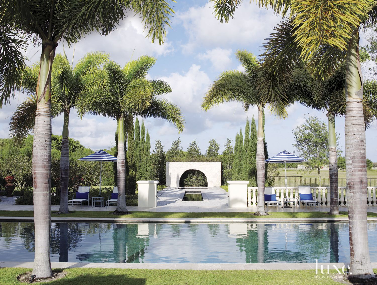 Contemporary Neutral Poolside with Countryside Landscaping