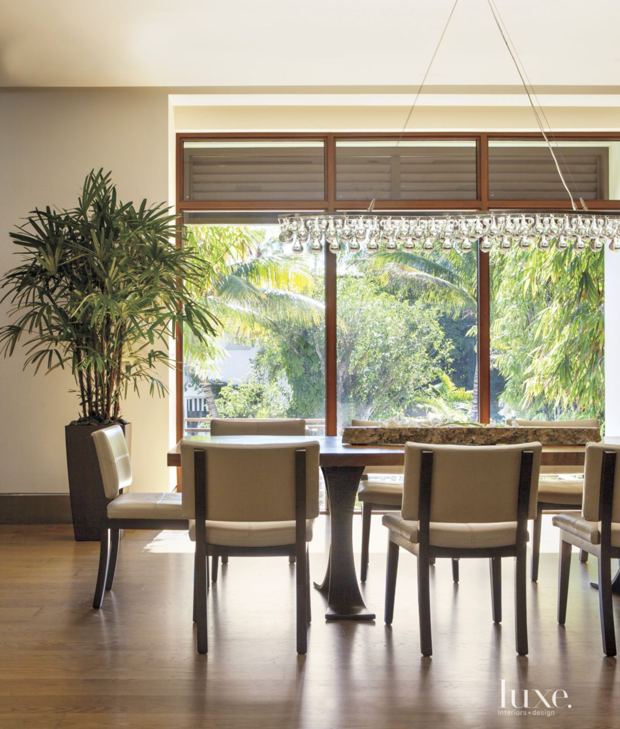 Contemporary Cream Dining Room with Picture Windows