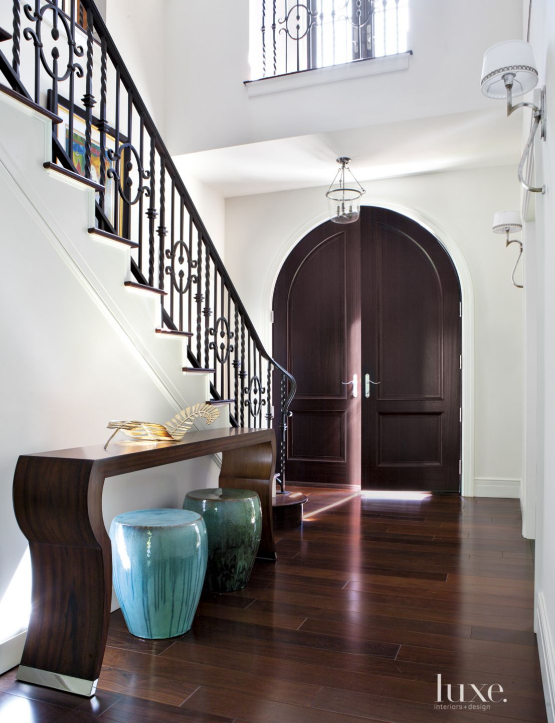Transitional White Entry with Brazilian Walnut Flooring