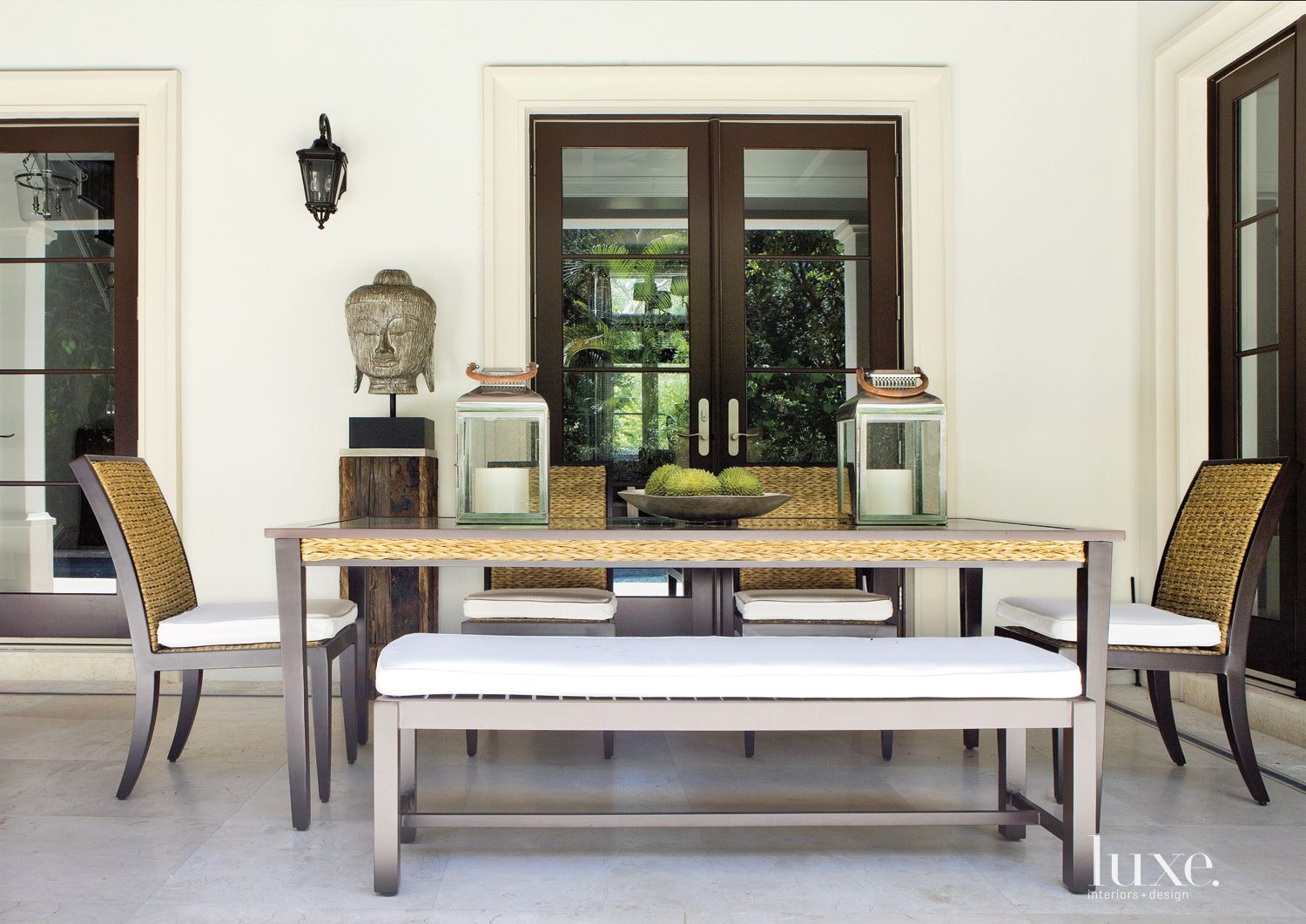 Transitional Dining Area with Buddha Head Statue