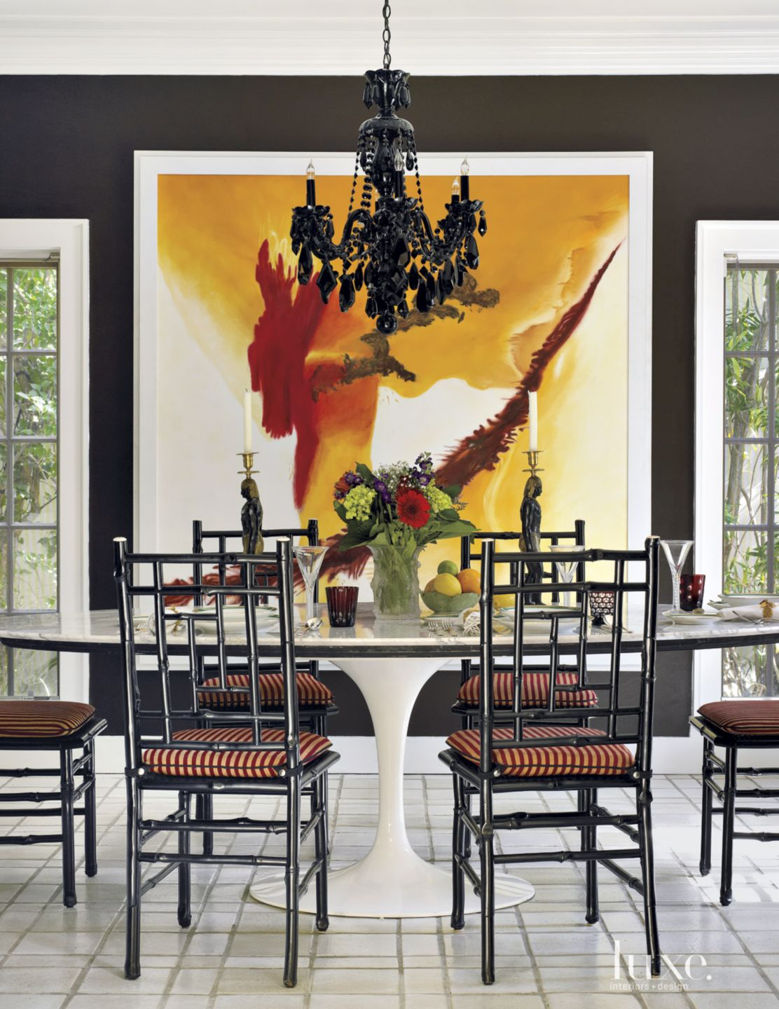 Transitional Black Dining Room with Contemporary Painting