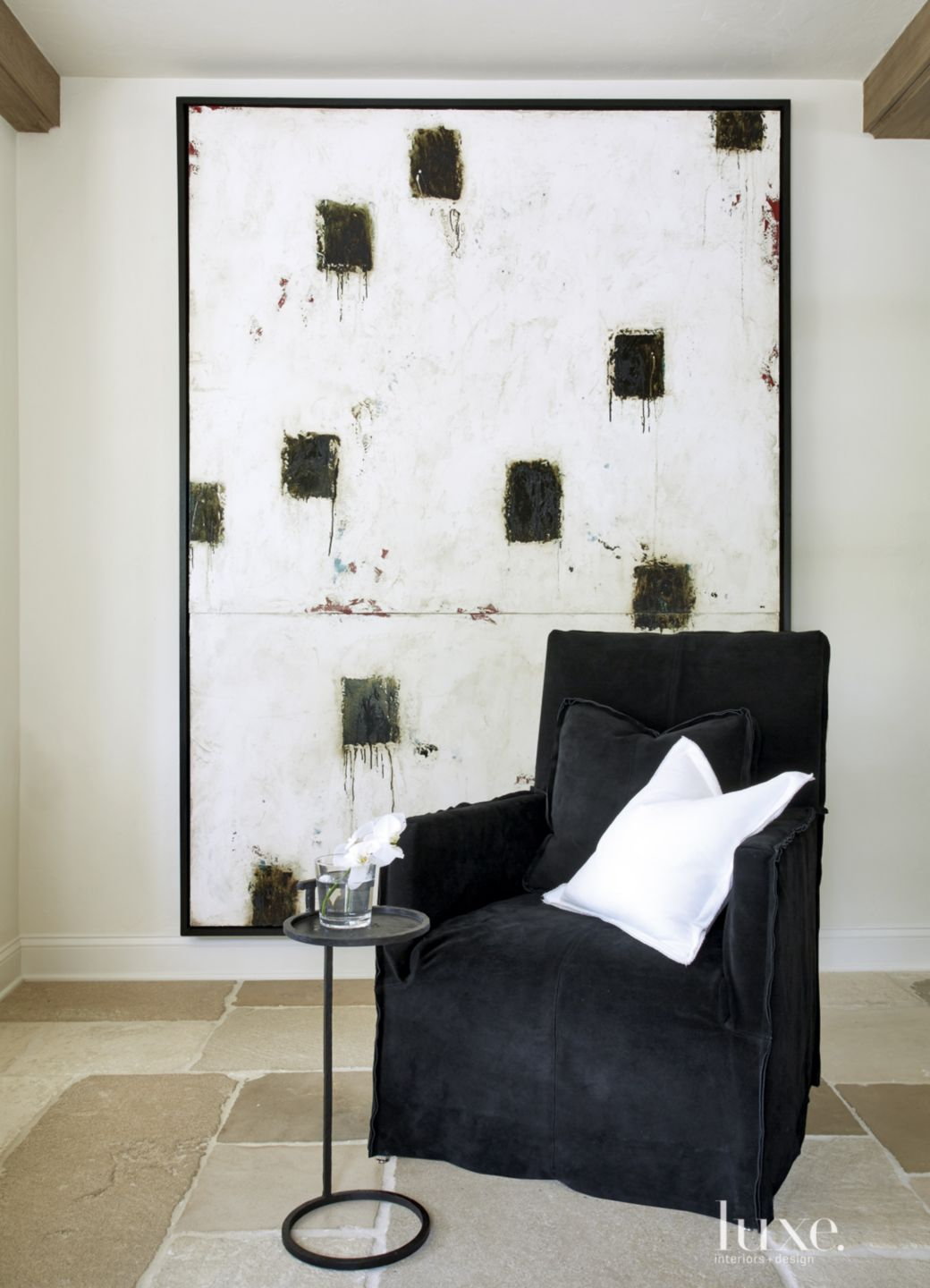 Contemporary White Sitting Area with Black Suede Chair