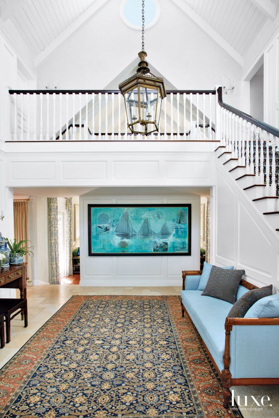 Traditional White Foyer with Pointed Ceiling