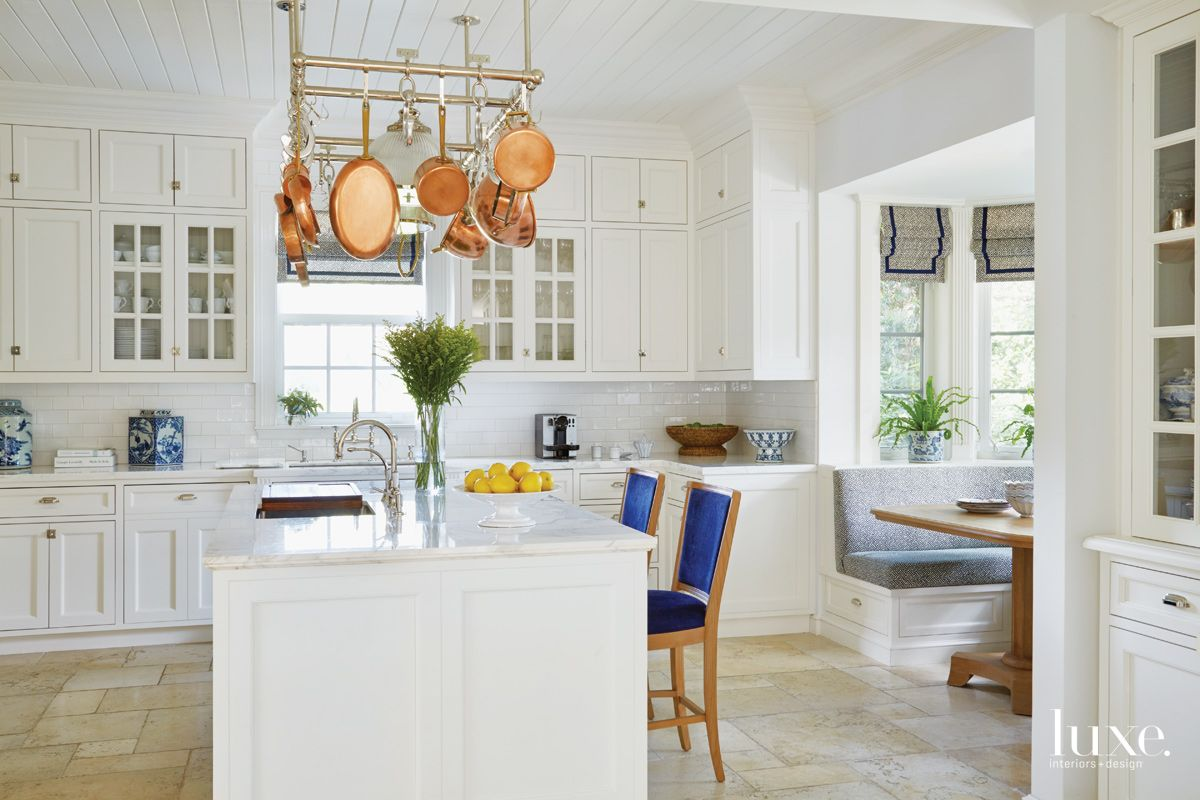 Traditional White Kitchen with Gold Marble Countertops