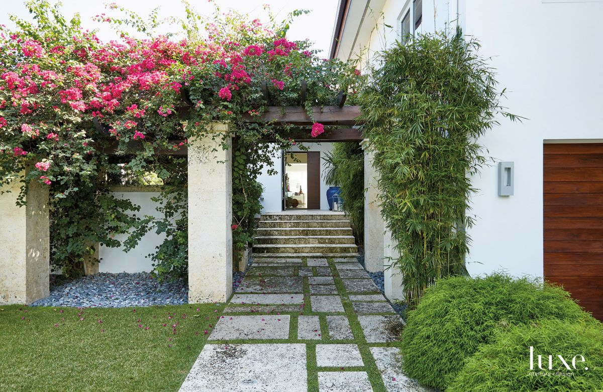 Contemporary White Entry with Fuchsia Flowers