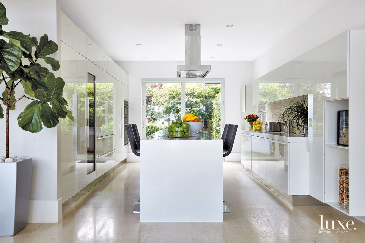 Contemporary White Kitchen with Flush-to-the-Wall Cabinetry