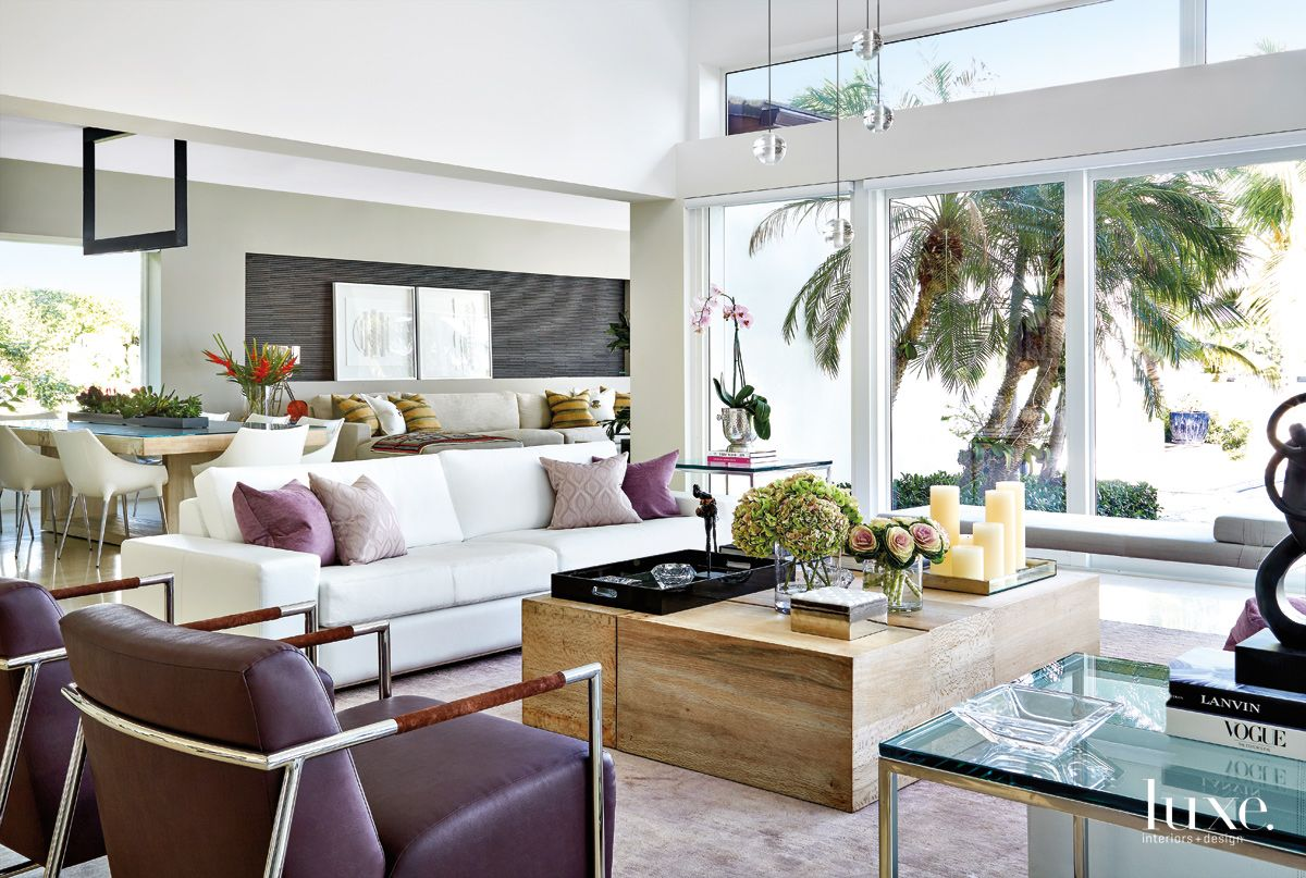 Contemporary White Living Room with Plum-Hued Chairs