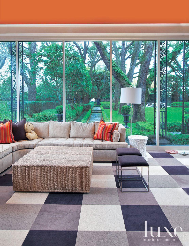Modern Orange Sunroom with Purple Rug
