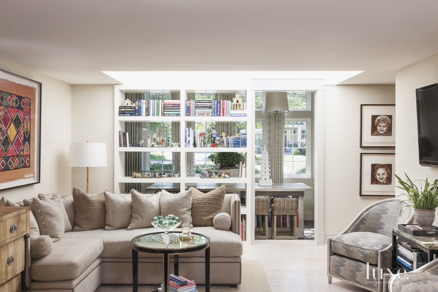 Eclectic White Living Room with Skylight
