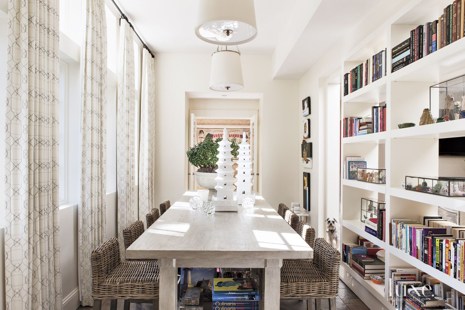 Eclectic White Study with Double-Sided Bookshelf