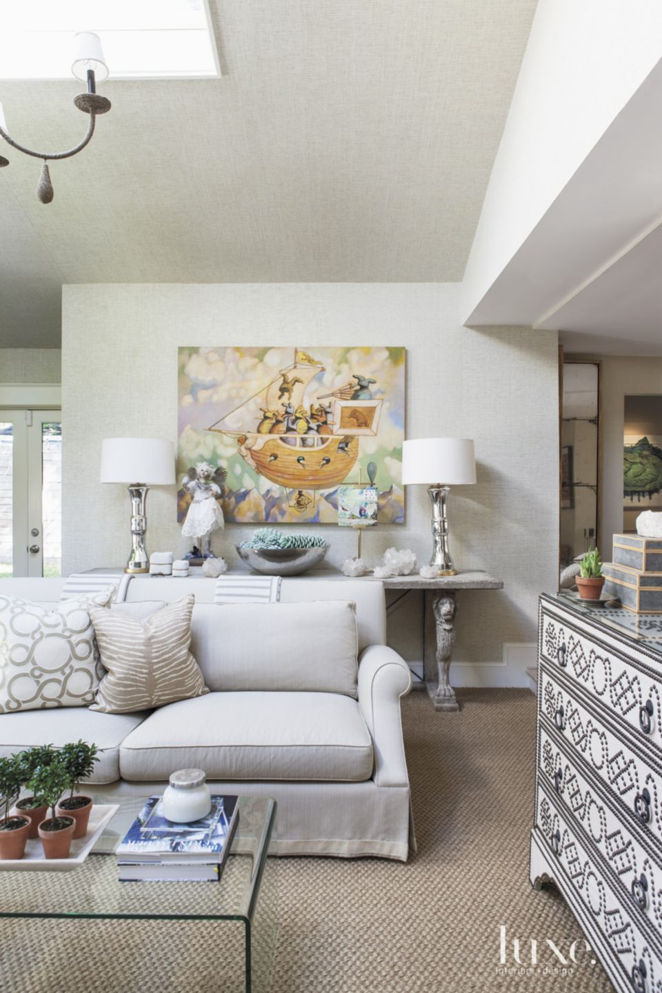 Eclectic White Living Room with Stone Console Table
