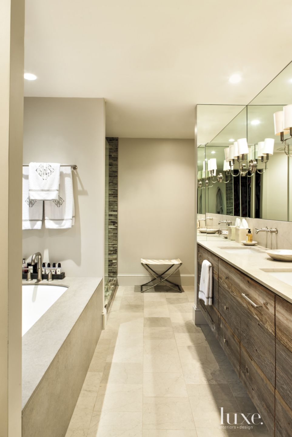 Contemporary White Bathroom with Mirrored Wall