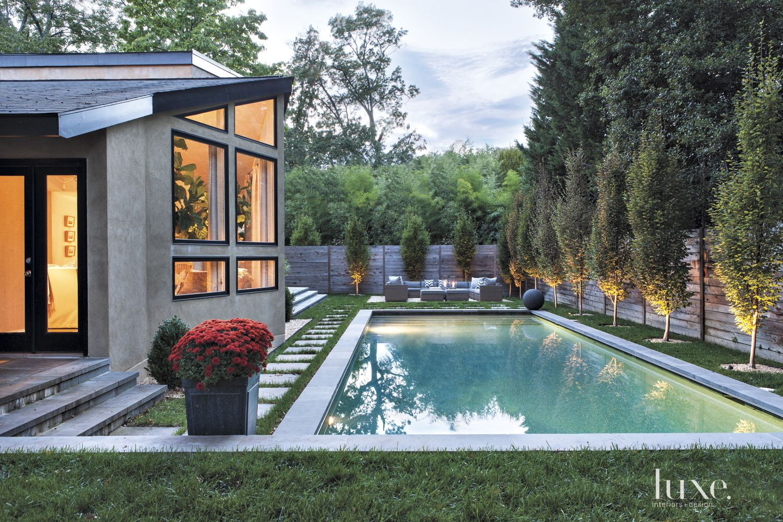 Contemporary Neutral Exterior with Treelined Backyard