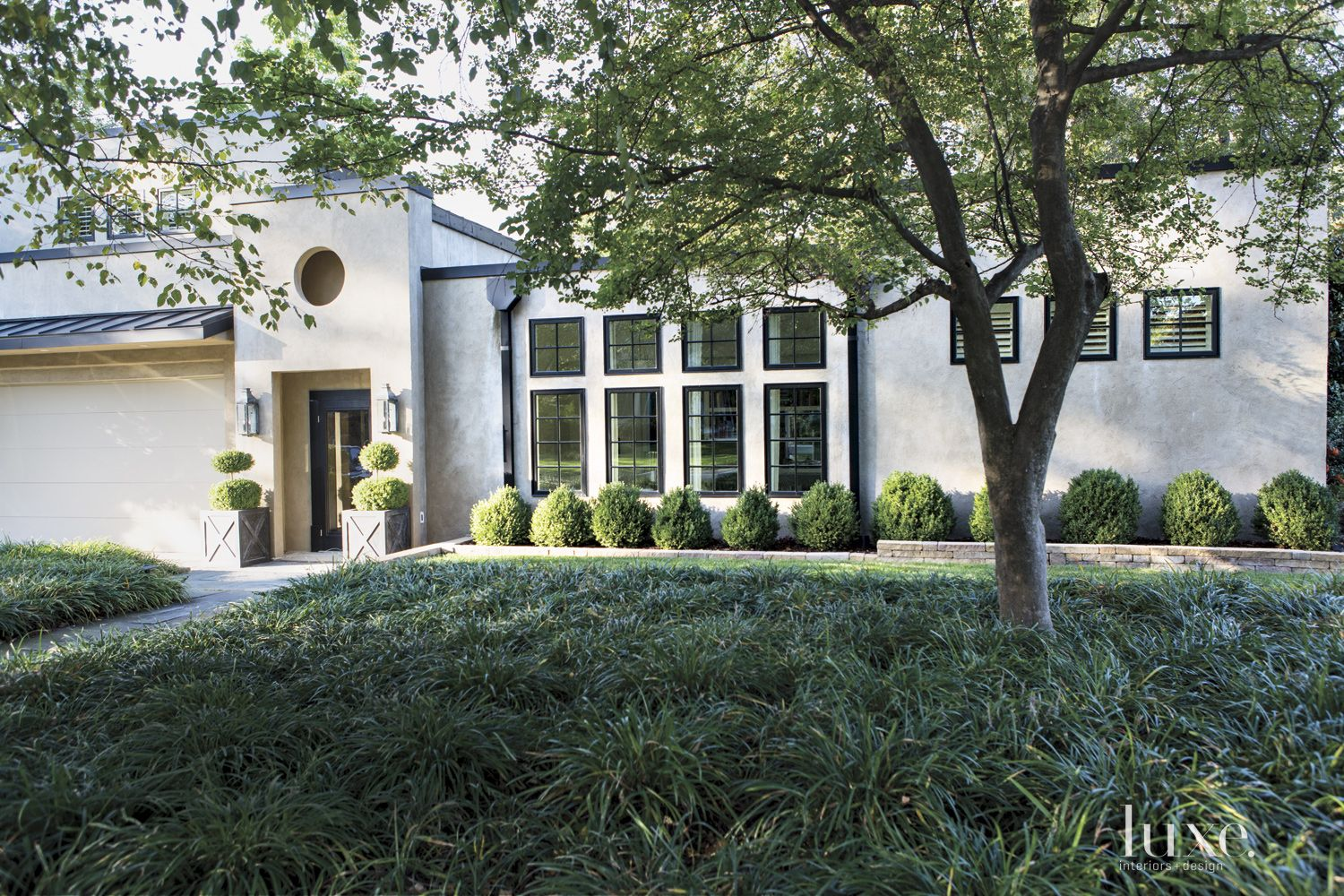 Contemporary Neutral Front Elevation with French Windows