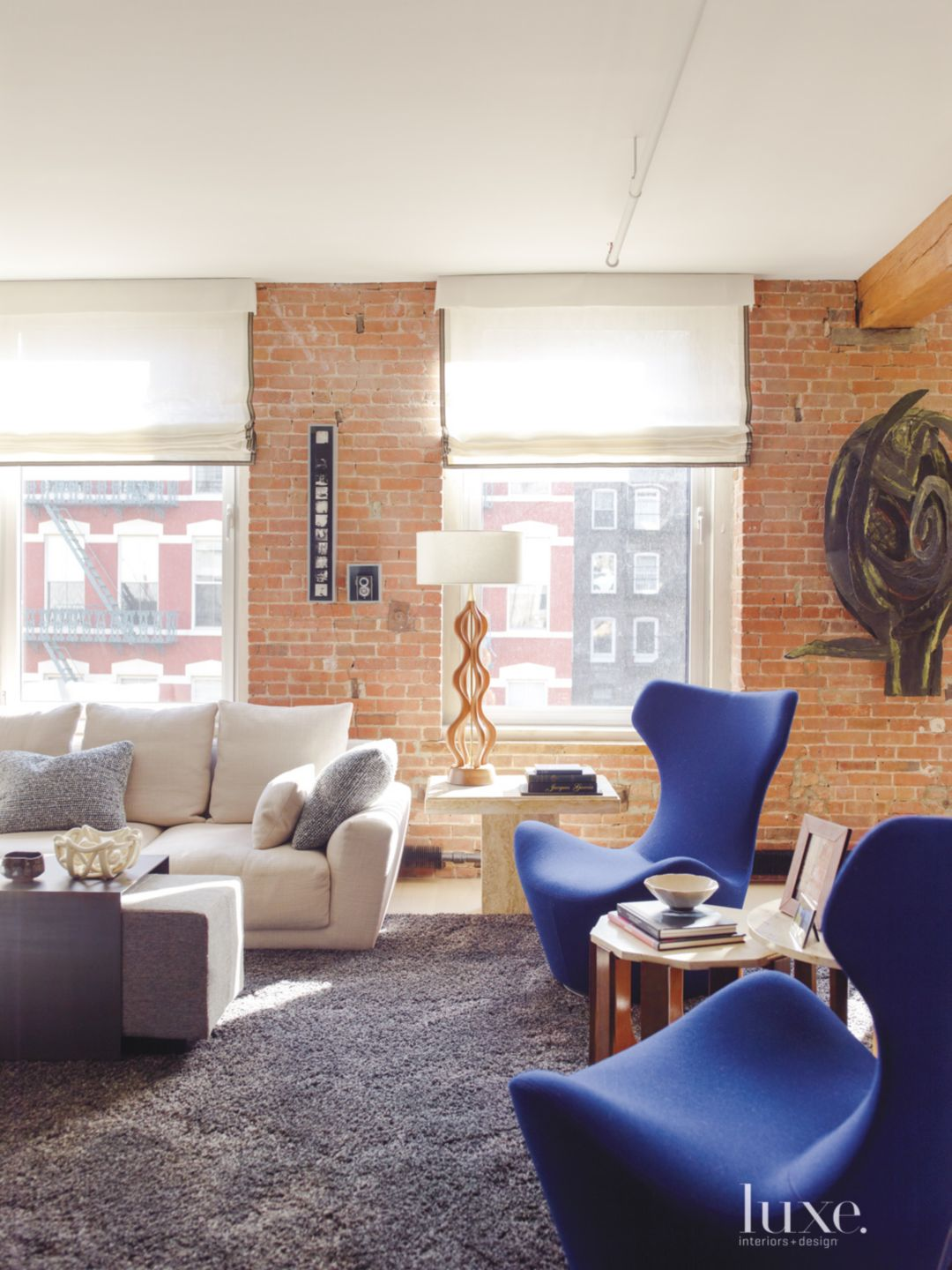 Eclectic Neutral Sitting Area with Exposed Brick