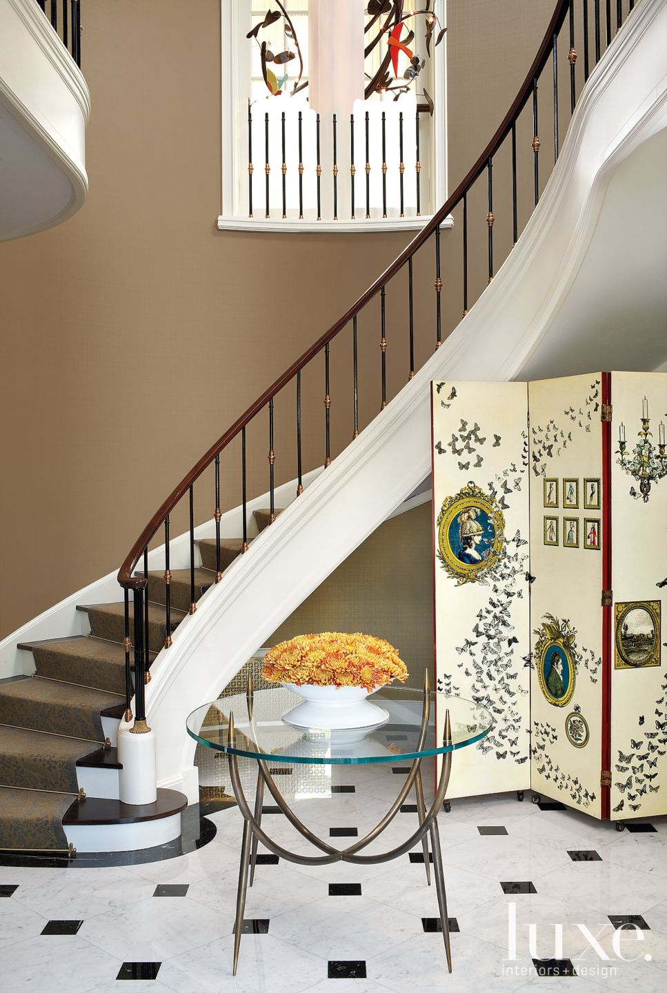 Eclectic Neutral Foyer with Curved Staircase