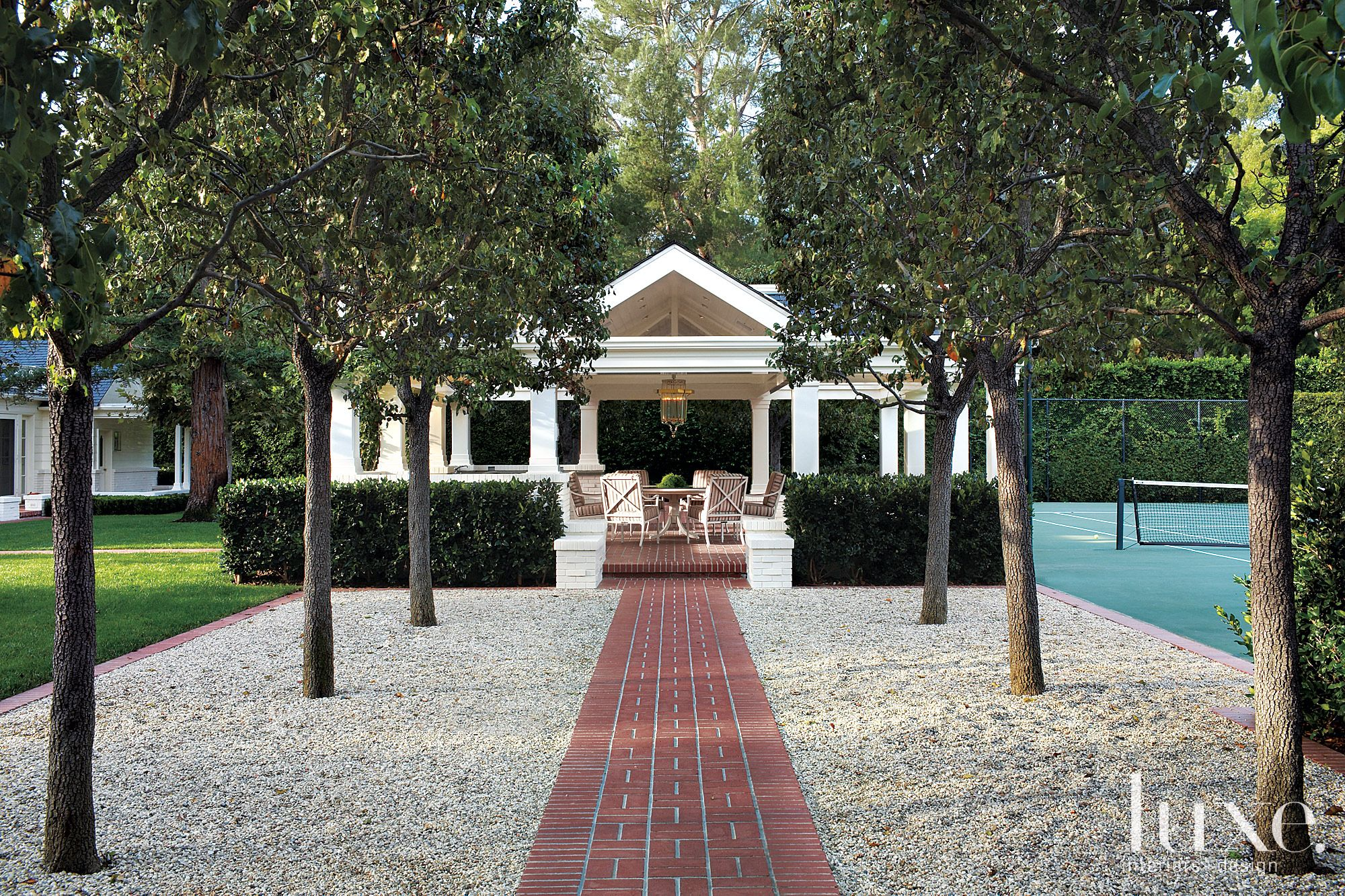 Transitional White Pavillion with Brick Paving