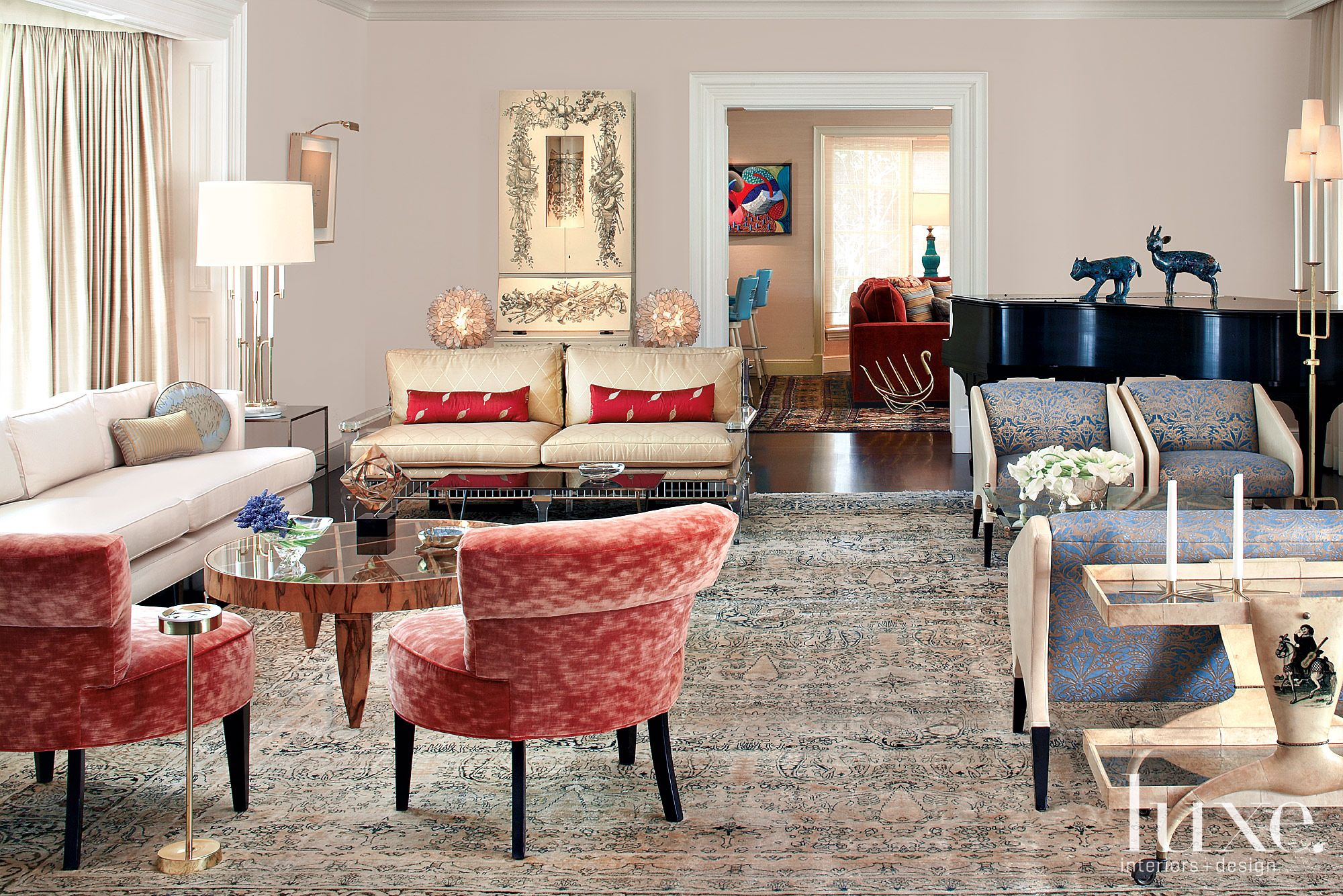 Eclectic White Living Room with Red and Blue Accents