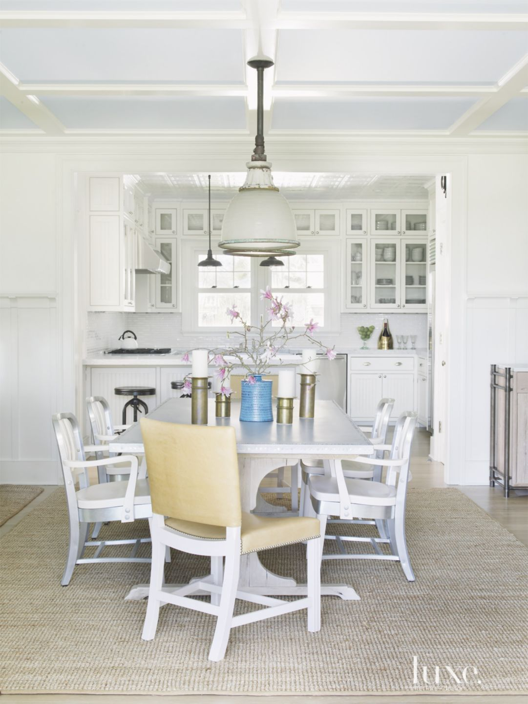 Transitional White Dining Area with Industrial Chairs
