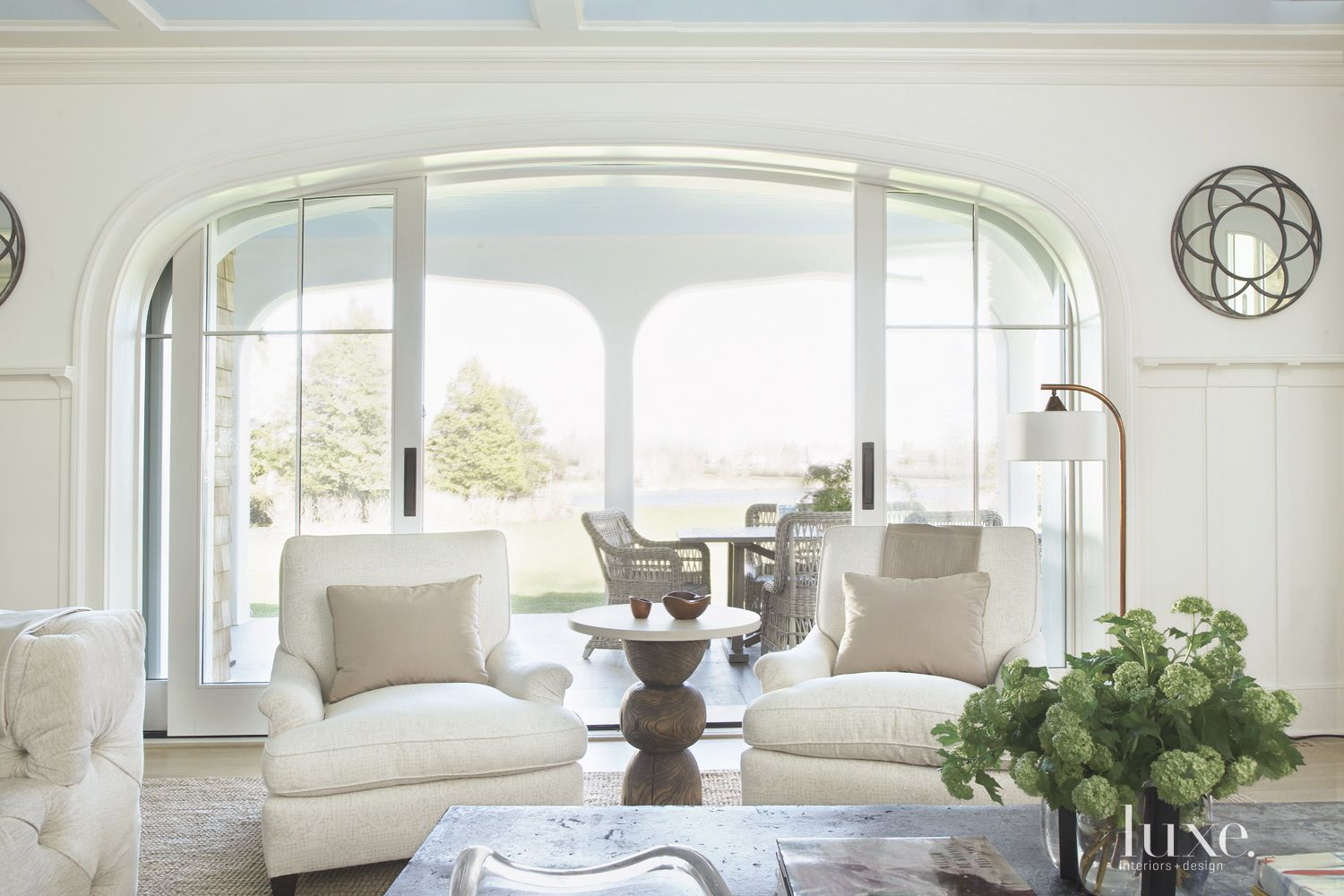 Transitional White Living Room with Pocket Doors