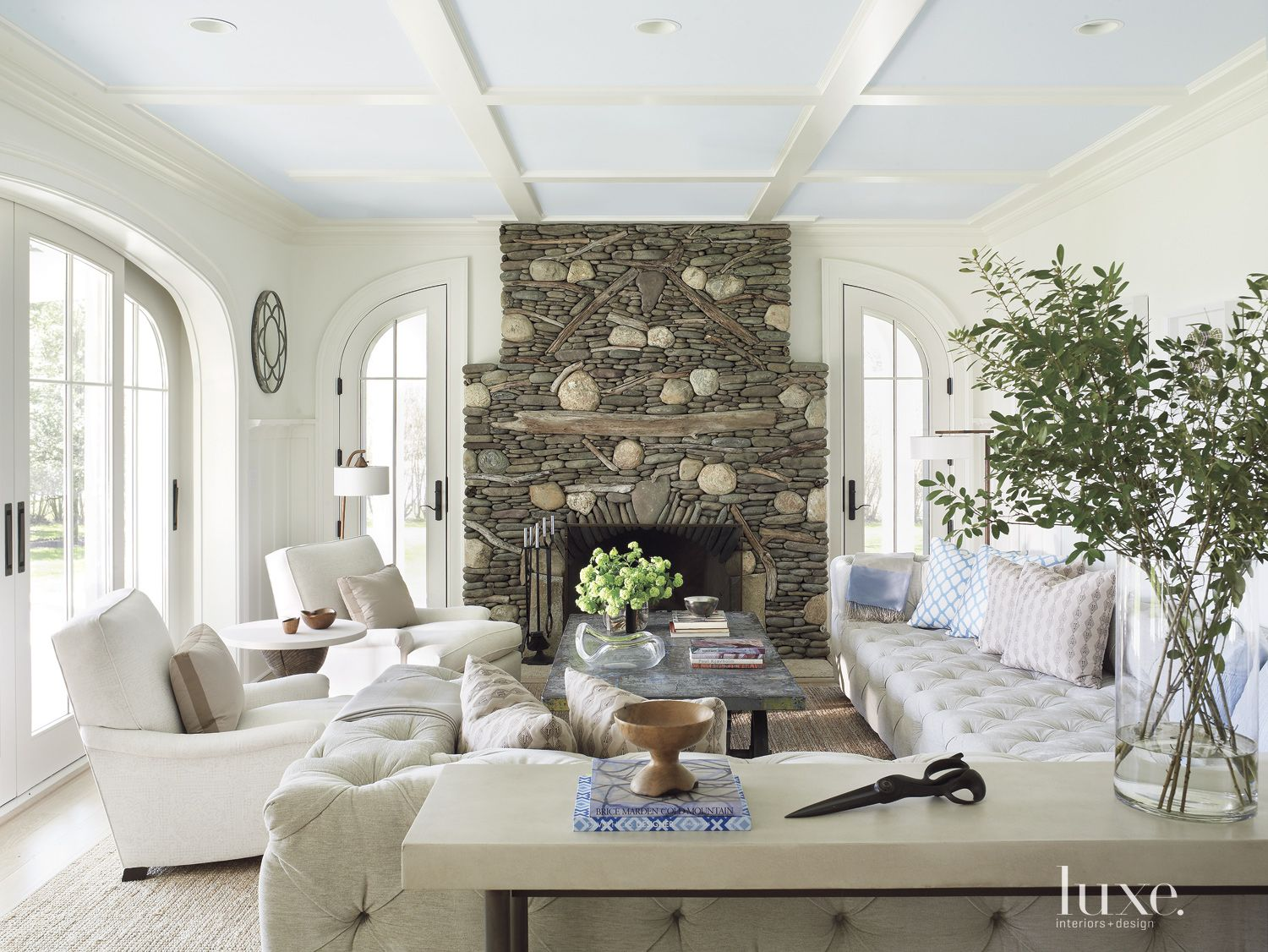 Transitional White Living Room with Stacked Stone Fireplace