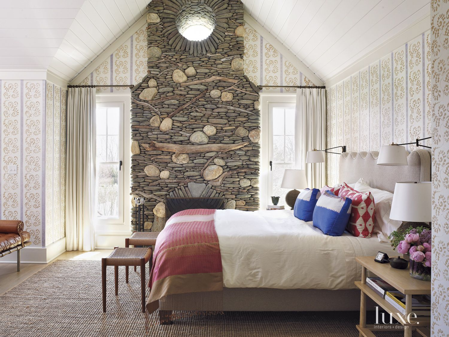 Transitional Neutral Bedroom with Stacked Stone Fireplace