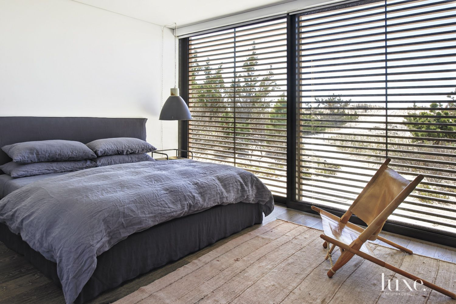 Contemporary White Bedroom with Slatted Walls