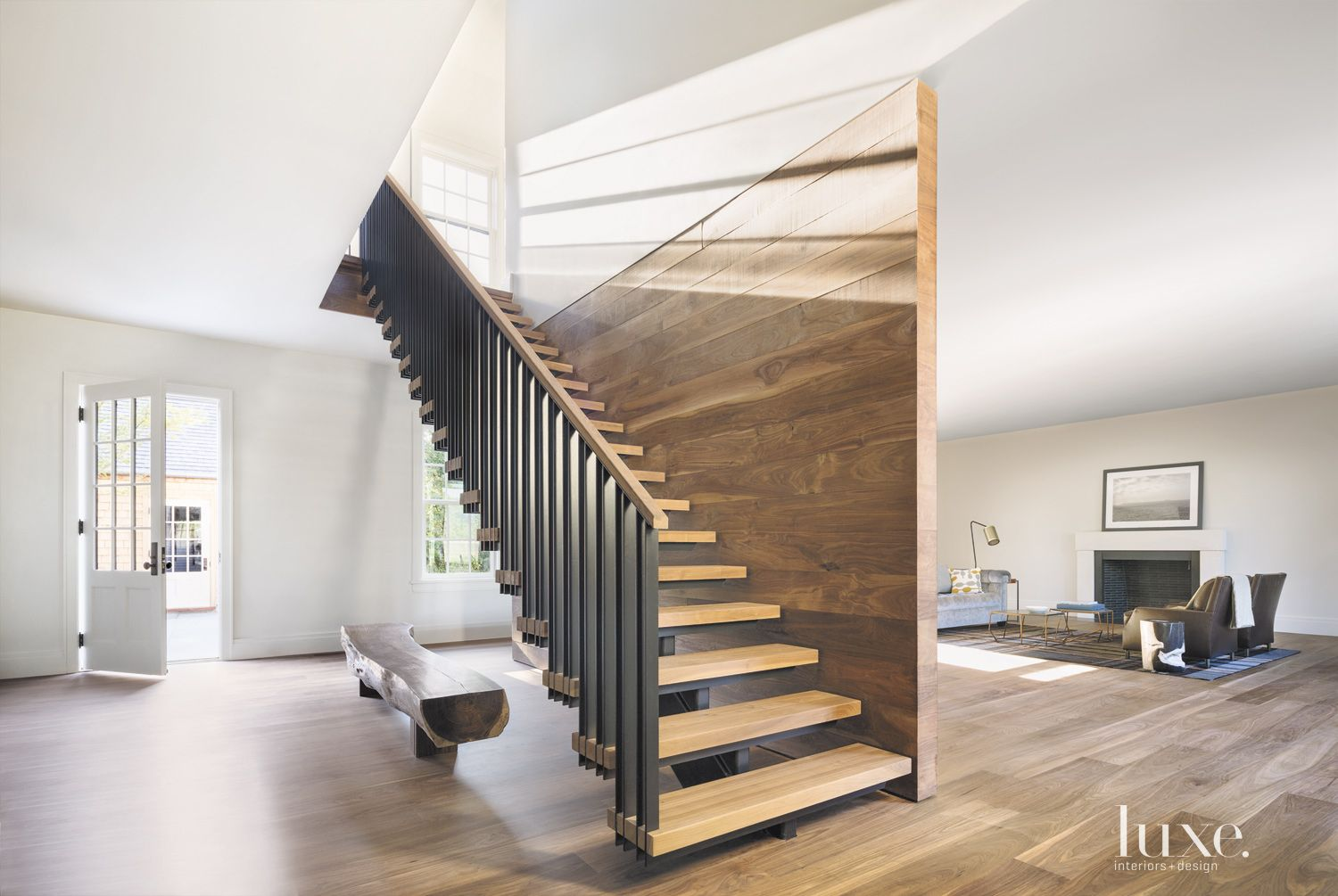 Modern White Staircase with Walnut Wall