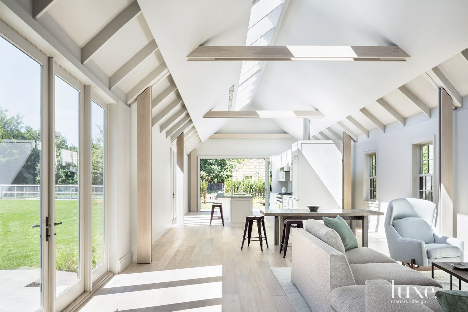 Modern White Sitting Area with Peaked Ceiling