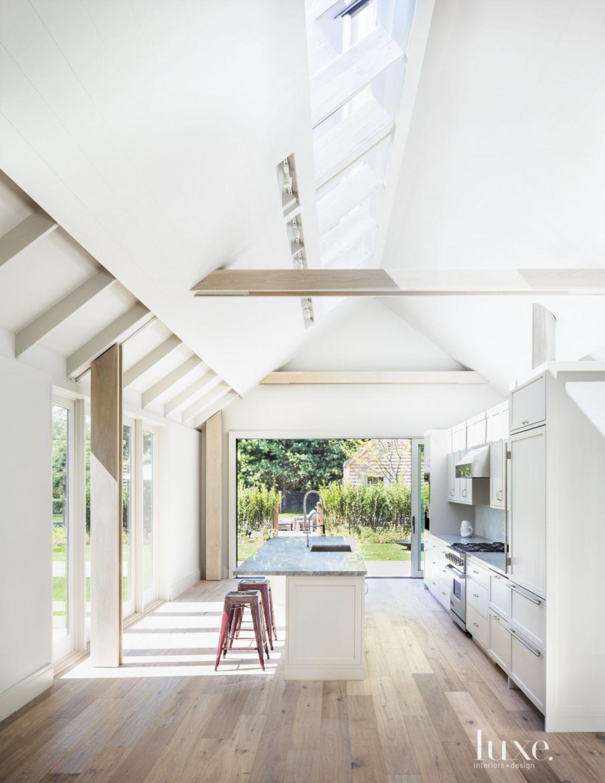 Modern White Kitchen with Sliding Glass Door