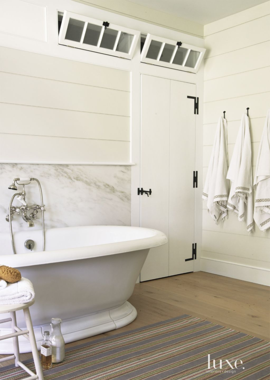 Country White Bathroom with Oval Soaking Tub