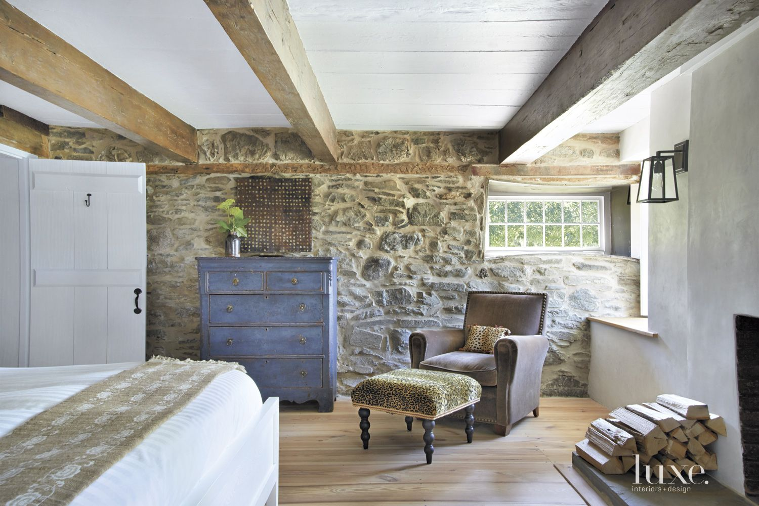 Neutral Country Bedroom with Exposed Beams