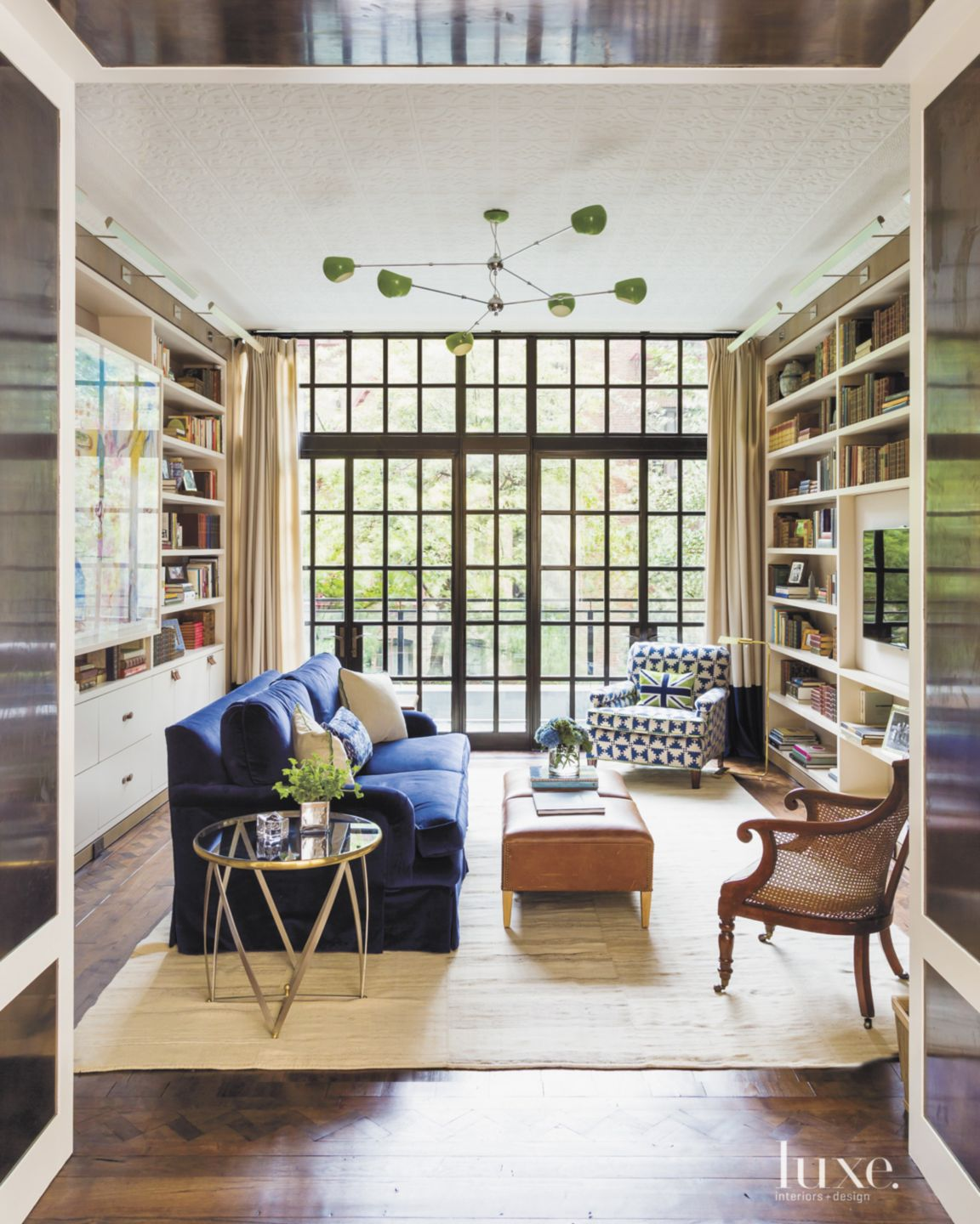 Eclectic Neutral Library with Blue Cotton-Velvet Sofa