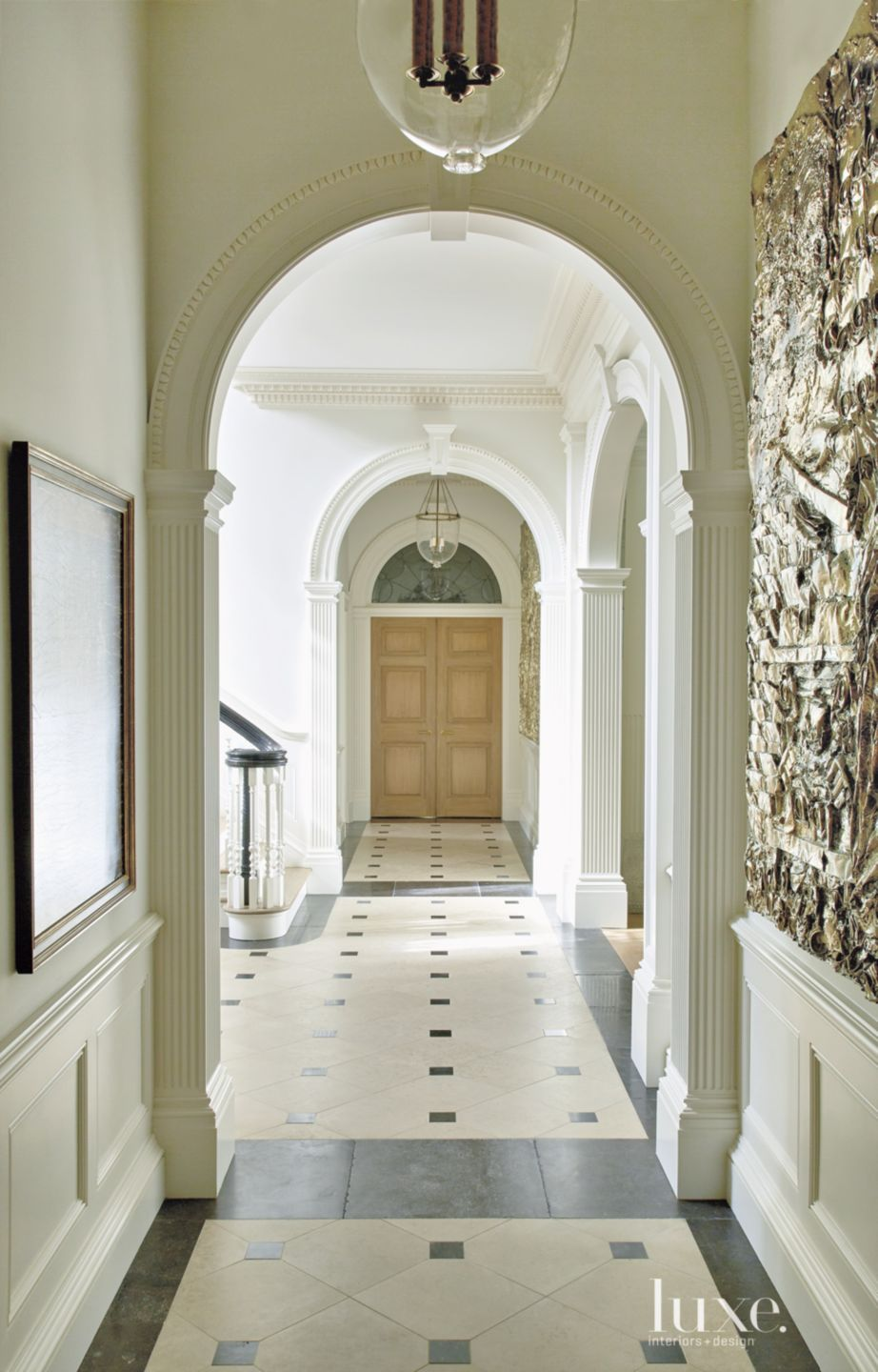 Traditional White Hallway with Arched Doorways
