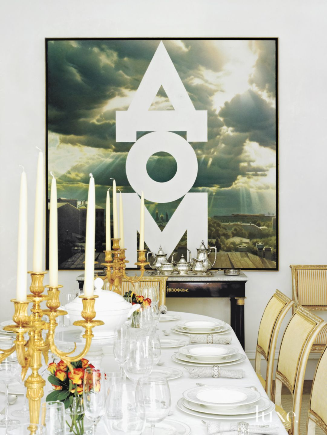 Traditional White Dining Room with Bold Art