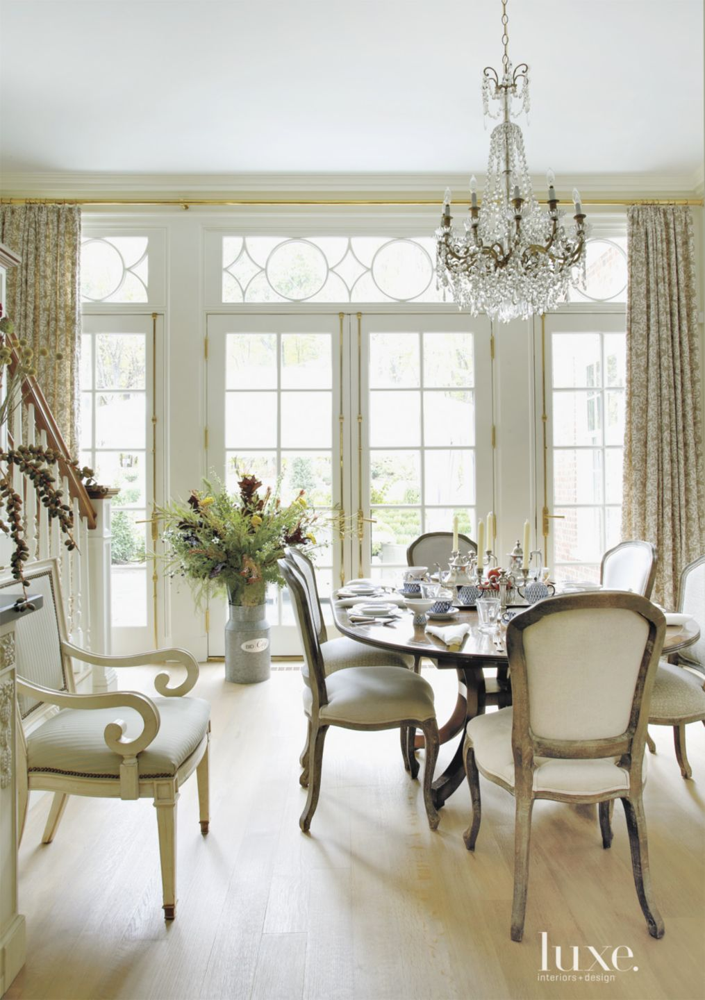 White Breakfast Area with Glass Chandelier