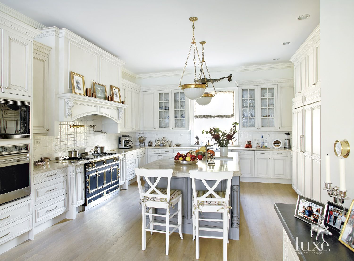Traditional White Kitchen with Brass Pendants