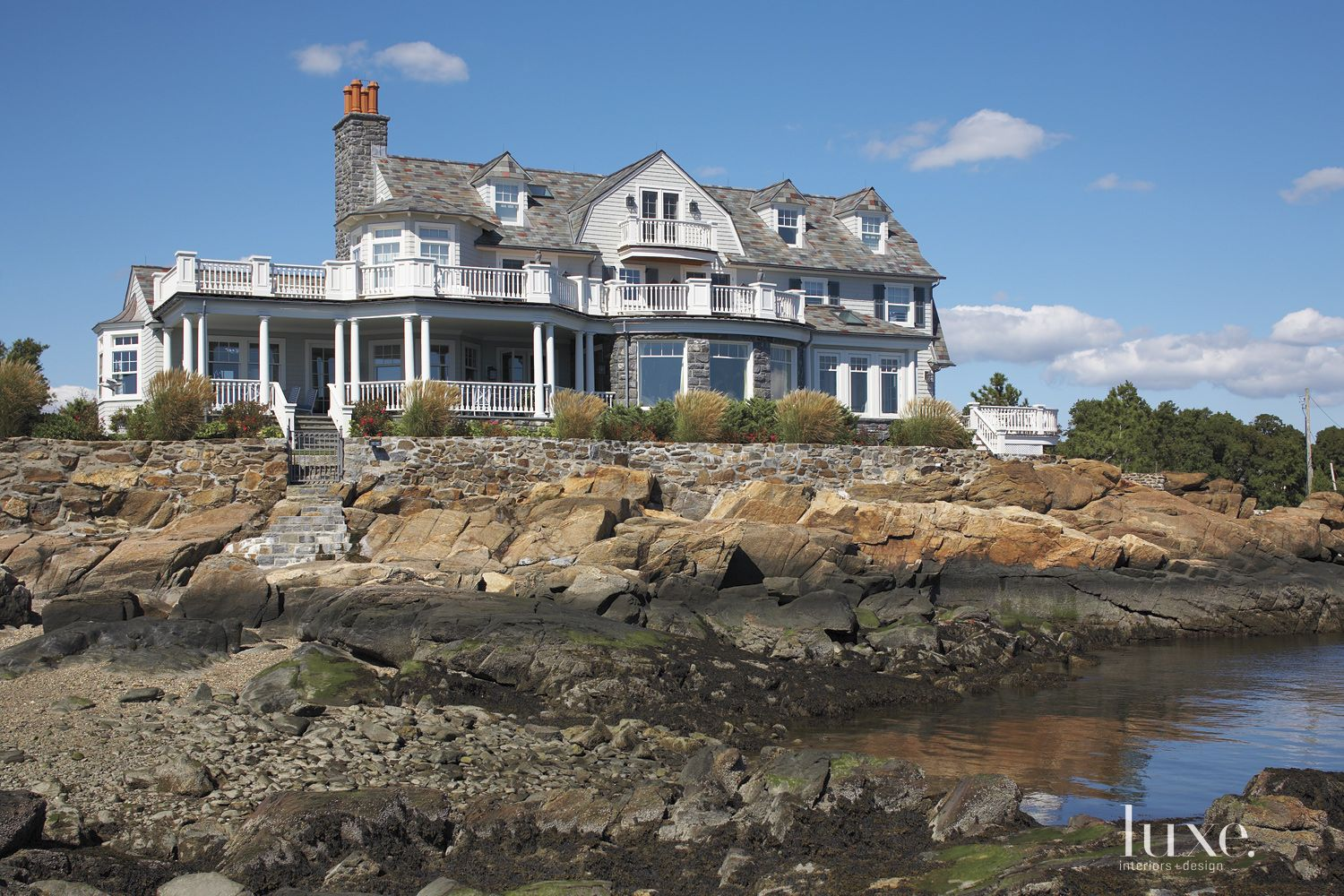 Traditional Neutral Exterior with Rocky Landscape