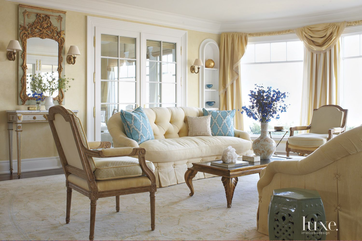 Traditional Yellow Living Room with Blue Accents