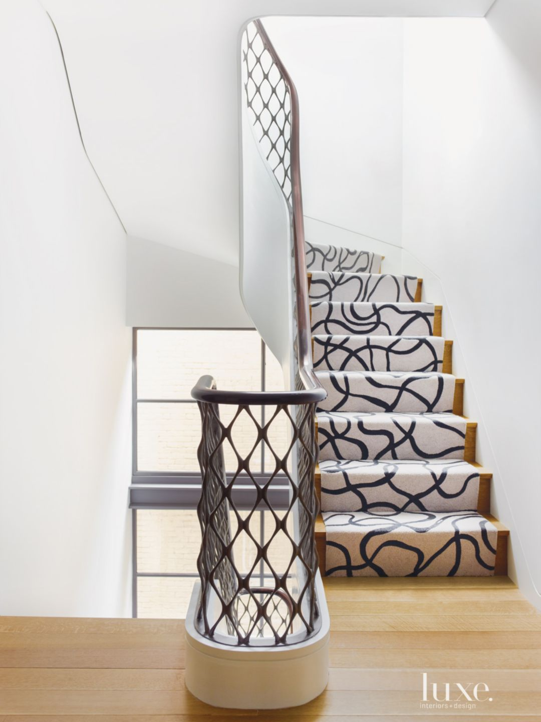 Modern Neutral Staircase with Lattice Railing